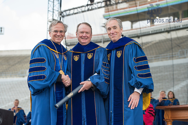 May 15, 2016; Richard Notebaert receives an honorary doctor of laws degrees during the 2016 Commencement ceremony at Notre Dame Stadium. (Photo by Barbara Johnston/University of Notre Dame)