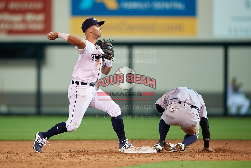 Lakeland Flying Tigers second baseman Anthony Pereira (9) throws to first base to try to complete a double play during a game against the Tampa Tarpons on April 5, 2018 at Publix Field at Joker Marchant Stadium in Lakeland, Florida.  Tampa defeated Lakeland 4-2.  (Mike Janes/Four Seam Images)