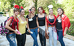 A group of pretty girl students studying tourism and hospitality welcoming tourists to the city, Seville, Spain