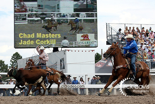 Cheyenne, Wyoming-7/26/2009-Photo by Rick Davis - PRCA cowboys Jade Corkill of Fallon, Nevada, and Chad Masters of Clarksville, Tennessee turned in a short go round time of 9.7 seconds in the team roping event during final round action at the 113th annual Cheyenne Frontier Days Rodeo. Jade and Chad posted a three head time of 27.7 seconds, which earned them the 2009 Cheyenne Team Roping Championship.
