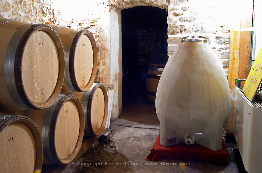 Domaine Clos Marie. Pic St Loup. Languedoc. Barrel cellar. Concrete fermentation and storage vats. France. Europe. Special shape oval concrete vat that creates automatic stirring of the lees and that are supposedly more bio-dynamic. Designed according to the Golden Rule Ratio.