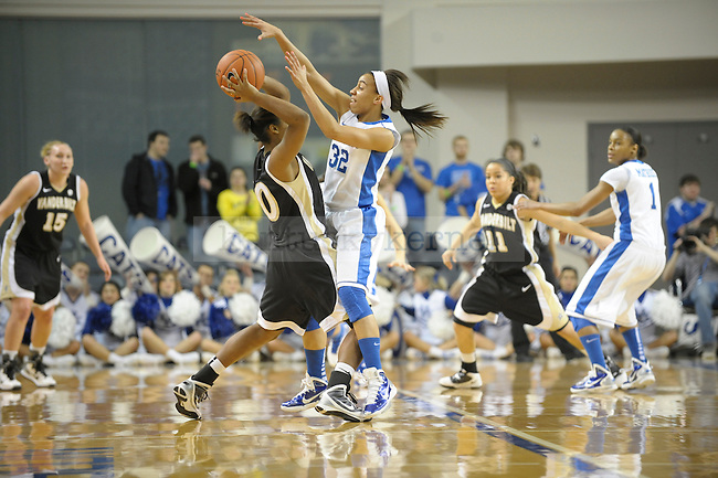 UK's Kastine Evans playing hard defense during the University of Kentucky Women's basketball game against Vanderbilt at Memorial Coliseum in Lexington, Ky., on 1/23/11. Uk led the game at half 37-22. Photo by Mike Weaver | Staff