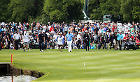 Thomas Bjorn heads up the 18th fairway - PGA European Tour Golf at Wentworth, Surrey 25/05/14 - MANDATORY CREDIT: Rob Newell/TGSPHOTO - Self billing applies where appropriate - 0845 094 6026 - contact@tgsphoto.co.uk - NO UNPAID USE