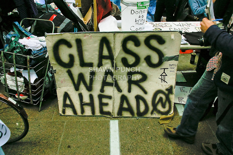 """Class War Ahead"" sign at the Occupy Wall Street protest encampment at Zuccotti Park, in Lower Manhattan, October 22, 2001."