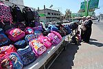 Palestinians shop at a market during preparation for the new school year in Gaza city, on August 22, 2019. Photo by Mahmoud Ajjour