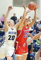 SNESH21P<br /> North Penn's Bri Hewlett #20 and Neshaminy's Devon Storms #34 battle for a rebound in the fourth quarter of a playoff basketball game Friday March 11, 2016 in Royersford, Pennsylvania.  (William Thomas Cain/For The Inquirer)