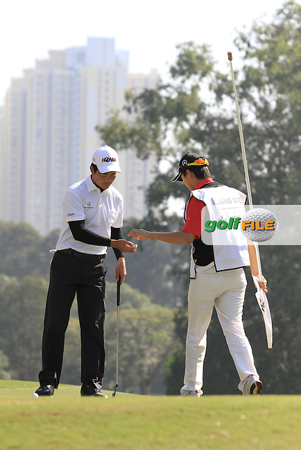 Liang Wen-chong (CHN) on the 3rd green on Day 3 of the UBS Hong Kong Open 2011...Photo GOLFFILE/Jenny Matthews.(Photo credit should read Jenny Matthews/GOLFFILE)..