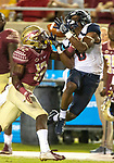 Florida State defensive back A.J. Lytton breaks up a Samford pass to Kelvin McKnight during the first half of an NCAA college football game in Tallahassee, Fla.,Saturday, Sept. 8, 2018.  Florida State defeated Samford 36 to 26.