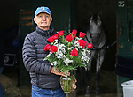 "Jason Servis, trainer of Maximum Security, who was disqualified from first place in the Kentucky Derby, stands outside his barn at Monmouth Park in Oceanport, New Jersey on Thursday morning May 9, 2019 with a dozen roses sent to him by an anonymous fan from North Carolina who wrote ""Great race, it seems as though someone forgot to give you roses"". Photo By Bill Denver/EQUI-PHOTO"
