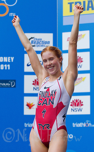 10 APR 2011 - SYDNEY, AUS - Paula Findlay celebrates victory at the women's ITU World Championship Series triathlon in Sydney, Australia  (PHOTO (C) NIGEL FARROW)