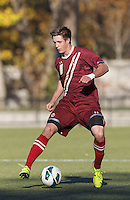 Boston College defender Matt Wendelken (8) controls the ball.Boston College (maroon) defeated Virginia Tech (Virginia Polytechnic Institute and State University) (white), 3-1, at Newton Campus Field, on November 3, 2013.
