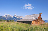 Remains of a historic Barn front the Grand Teton Range along Mormon Row frame the Teton Range.  Grand Teton National Park, United States, Wyoming.  Mormon Row is a line of historic homesteads along Jackson-Moran Road, Grand Teton National Park.  Please contact the photographer regarding licensing this image.