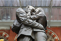 "Lovers touching foreheads as they clasp, monumental bronze sculpture titled ""The Meeting Place"" (detail), by Paul Day, 2007, Eurostar's London terminal, St Pancras, London, UK. Picture by Manuel Cohen"