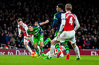 Jack Cork of Swansea City  urges through the arsenal defence during the Barclays Premier League match between Arsenal and Swansea City at the Emirates Stadium, London, UK, Wednesday 02 March 2016