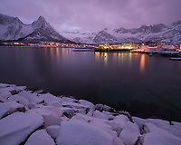 Winter evening view across harbor at village of Mefjordvær, Senja, Norway