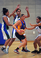 Action from the 2015 Women's Basketball Championship plate match between the Waitakere Lady Rangers (white and blue) and Te Tai Tokerau Phoenix (navy and gold) at Te Rauparaha Arena, Porirua, Wellington, New Zealand on Thursday, 4 June 2015. Photo: Dave Lintott / lintottphoto.co.nz