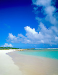Anguilla, BWI<br /> A white sand beach and blue waters compliment the colors of the clouds and sky overhead on Savannah Bay on the north shore of Anguilla