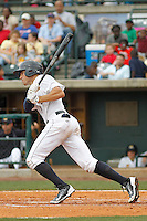 Charleston RiverDogs outfielder Brandon Thomas (6) at bat during a game against the Augusta GreenJackets at Joseph P.Riley Jr. Ballpark on April 15, 2015 in Charleston, South Carolina. Charleston defeated Augusta 8-0. (Robert Gurganus/Four Seam Images)
