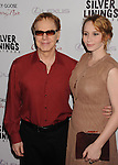 BEVERLY HILLS, CA - NOVEMBER 19: Danny Elfman and Mali Elfman arrive at the 'Silver Linings Playbook' - Los Angeles Special Screening at the Academy of Motion Picture Arts and Sciences on November 19, 2012 in Beverly Hills, California.