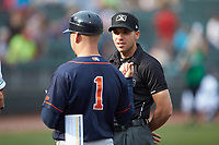 Base umpire Harrison Silverman meets with Bowling Green Hot Rods manager Craig Albernaz (1) prior to the game against the Dayton Dragons at Fifth Third Field on June 9, 2018 in Dayton, Ohio. The Hot Rods defeated the Dragons 1-0.  (Brian Westerholt/Four Seam Images)