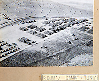 BNPS.co.uk (01202 558833)<br /> Pic: PhilYeomans/BNPS<br /> <br /> German POW camp near Tunis.<br /> <br /> Unearthed - fascinating unseen archive of cameras, photographs, documents and medals from a British aerial reconnaisance expert who fought all the way through Africa and southern Europe in WW2.<br /> <br /> Flt Lt Eric Cooper from London kept all his wartime paraphernalia, including his K20 handheld camera and stereoscopic plotting instruments until his death in Devon aged 96 in 2012.<br /> <br /> The incredible photographs show bombing raids, amphibious landings and badly damaged aircraft alongside off duty snaps of the campaign throughout the mediterraenean.<br /> <br /> His nephew is now selling the compelling collection at Plymouth Auction Rooms in Devon next week.