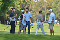 The group of Jon Rahm (ESP), Dustin Johnson (USA), and Justin Thomas (USA) finish their round 1 of the World Golf Championships, Mexico, Club De Golf Chapultepec, Mexico City, Mexico. 3/1/2018.<br /> Picture: Golffile | Ken Murray<br /> <br /> <br /> All photo usage must carry mandatory copyright credit (&copy; Golffile | Ken Murray)