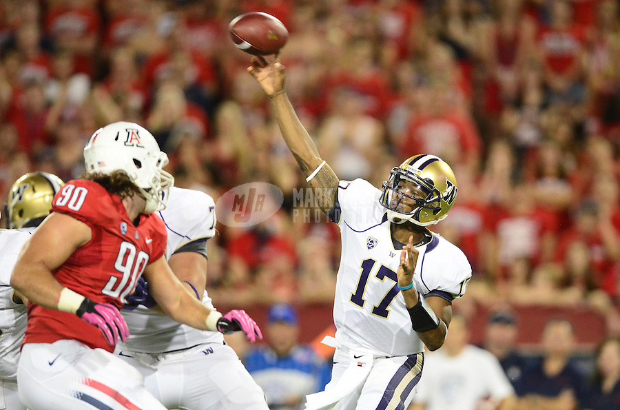 Oct. 20, 2012; Tempe, AZ, USA; Washington Huskies quarterback (17) Keith Price throws a pass against the Arizona Wildcats in the first quarter at Arizona Stadium. Mandatory Credit: Mark J. Rebilas-