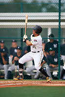 GCL Pirates left fielder John Lantigua (26) follows through on a swing during the first game of a doubleheader against the GCL Yankees East on July 31, 2018 at Pirate City Complex in Bradenton, Florida.  GCL Yankees East defeated GCL Pirates 2-0.  (Mike Janes/Four Seam Images)