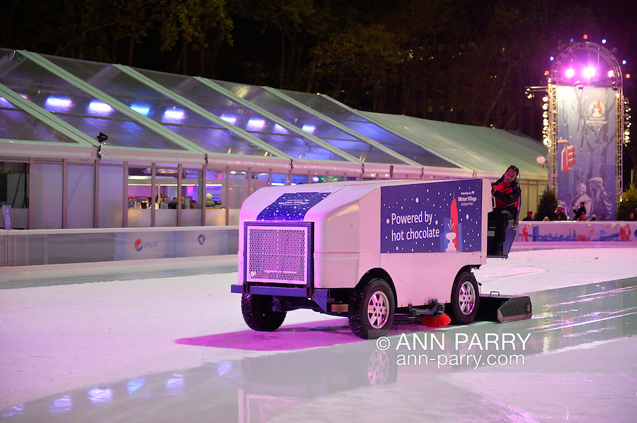 Manhattan, New York, U.S. 9th November 2013. Visitors ice skate and shop at the annual Holiday Shops, and Zamboni ice resurfacer works on ice, at Winter Village skating rink at Bryant Park that night,