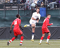 University of Connecticut midfielder Colin Bradley (20) heads the ball. .NCAA Tournament. With a goal in the second overtime, University of Connecticut (white) defeated University of New Mexico (red), 2-1, at Morrone Stadium at University of Connecticut on November 25, 2012.
