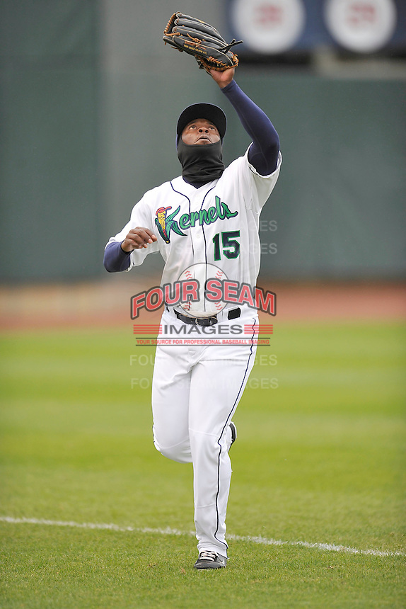 Ivory Thomas #15 of the Cedar Rapids Kernels makes a running catch in left field against the Kane County Cougars at Perfect Game Field on May 1, 2014 in Cedar Rapids, Iowa. The Kernels won 5-2.   (Dennis Hubbard/Four Seam Images)