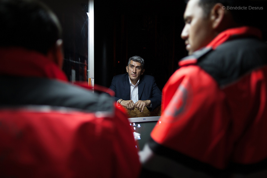 "Donovan explains his work and gives his business card to members of firefighting service in Mexico City on June 1, 2015. Donovan Tavera, 43, is the director of ""Limpieza Forense México"", the country's first and so far the only government-accredited forensic cleaning company. Since 2000, Tavera, a self-taught forensic technician, and his family have offered services to clean up homicides, unattended death, suicides, the homes of compulsive hoarders and houses destroyed by fire or flooding. Despite rising violence that has left 70,000 people dead and 23,000 disappeared since 2006, Mexico has only one certified forensic cleaner. As a consequence, the biological hazards associated with crime scenes are going unchecked all around the country. Photo by Bénédicte Desrus"