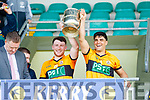 Conor Jordan and Wayne Guthrie Austin Stacks lift the cup after winning the Kerry Club Championship Final on Sunday.