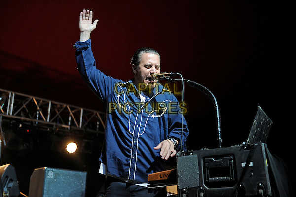 Mike Patton<br /> Tomahawk performing on the Lock Up stage, Reading Festival, Reading, England. <br /> 24th August 2013<br /> on stage in concert live gig performance performing music half length blue shirt  singing hand arm in air <br /> CAP/MAR<br /> &copy; Martin Harris/Capital Pictures