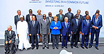 (1st row L-R) Malian President Ibrahim Boubacar Keita,Egyptian President Abdel Fattah al-Sisi, Guinean President and Chairman of the African Union Alpha Conde, German Chancellor Angela Merkel, Tunesian President Beji Caid Essebsi, Senegalese President Macky Sall ; (2nd row L-R) the President of the African Development Bank Akinwumi Adesina, the Managing Director of the International Monetary Fund Christine Lagarde, Ghanaian President Nana Akufo Addo, Italy's Prime Minister Paolo Gentiloni, Rwandan President Paul Kagame, the President of the World Bank Group Jim Yong Kim, Ivorian President Alassane Ouattara an Chairman of the African Union Commission Moussa Faki pose for a family picture during a two-day G20 Africa partnership investment conference in Berlin on June 12, 2017. Photo by Egyptian President Office
