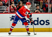 WASHINGTON, DC - JANUARY 31: Dmitry Orlov #9 of the Washington Capitals  sends the puck up ice during a game between New York Islanders and Washington Capitals at Capital One Arena on January 31, 2020 in Washington, DC.