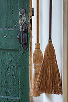 Broom and old door in traditional Shaker house.