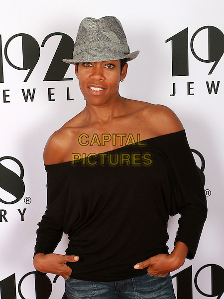 REGINA KING .Visits 2011 Golden Globes Gifitng Services suite On her Birthday held At Gifting Services Showroom, West Westwood, CA, USA, .15th January 2011..half length top grey gray hat fedora off the shoulder hands in pockets herringbone .CAP/ADM/KB.©Kevan Brooks/AdMedia/Capital Pictures.