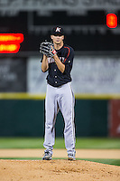 Kannapolis Intimidators starting pitcher Spencer Adams (12) looks to his catcher for the sign against the Hickory Crawdads at L.P. Frans Stadium on April 23, 2015 in Hickory, North Carolina.  The Crawdads defeated the Intimidators 3-2 in 10 innings.  (Brian Westerholt/Four Seam Images)