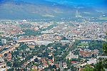 View of Innsbruck from the hill. Aerial photo of Innsbruck streets, buildings and sports constructions