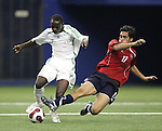 15 July 2007: Chile's Hans Martinez (17) tries to tackle the ball away from Nigeria's Bello Kofarmata (7). Chile's Under-20 Men's National Team defeated Nigeria's Under-20 Men's National Team 4-0 after extra time in a  quarterfinal match at Olympic Stadium in Montreal, Quebec, Canada during the FIFA U-20 World Cup Canada 2007 tournament.