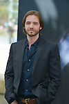 """Aaron Stanford from Cast """"12 Monkeys"""" poses at the photocall during the 55th Festival TV in Monte-Carlo on June 15, 2015 in Monte-Carlo, Monaco."""