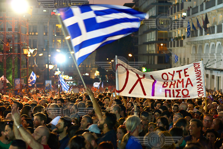 A large crowd supporting a 'No' vote gathered in Syntagma Square on the day before a national referendum to acceptance or reject economic reforms demanded by the country's creditors. The outcome could determine whether or not Greece remains in the Eurozone and if it will continue to receive further financial assistance from the 'Troika' of the IMF, EU and European Central Bank.