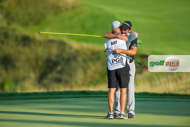 Jason Day (Aust) hugs his caddie, Col Swanton after winning the 2015 USPGA Championship at Whistling Straits (Photo: Anthony Powter)