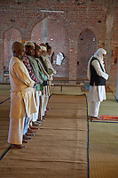 Worshipers Praying in Mosque under Construction, Madrasa Islamia Arabia Izharul-Uloom, Dehradun, India.