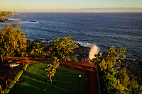 Aerial view of the iconic Spouting Horn blowhole at Spouting Horn Park on the south shore of Kaua'i.