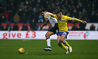 Leeds United's Kalvin Phillips and Bolton Wanderers' Josh Magennis<br /> <br /> Photographer Stephen White/CameraSport<br /> <br /> The EFL Sky Bet Championship - Bolton Wanderers v Leeds United - Saturday 15th December 2018 - University of Bolton Stadium - Bolton<br /> <br /> World Copyright &copy; 2018 CameraSport. All rights reserved. 43 Linden Ave. Countesthorpe. Leicester. England. LE8 5PG - Tel: +44 (0) 116 277 4147 - admin@camerasport.com - www.camerasport.com