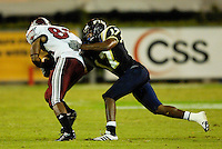 Florida International University Golden Panthers (0-5, 0-1 SBC)  versus the Troy University Trojans (3-2, 2-0 SBC) at the Orange Bowl, Miami, Florida on Saturday, October 6, 2007...Junior defensive back Robert Mitchell (17) (Melbourne, Fla.) tackles Troy's Kennard Burton (88).