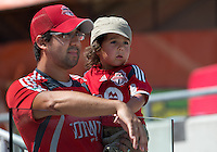 20 July 2013: A young fan gets his first look at the players with his Dad during an MLS regular season game between the New York Red Bulls and Toronto FC at BMO Field in Toronto, Ontario Canada.<br /> The game ended in a 0-0 draw.