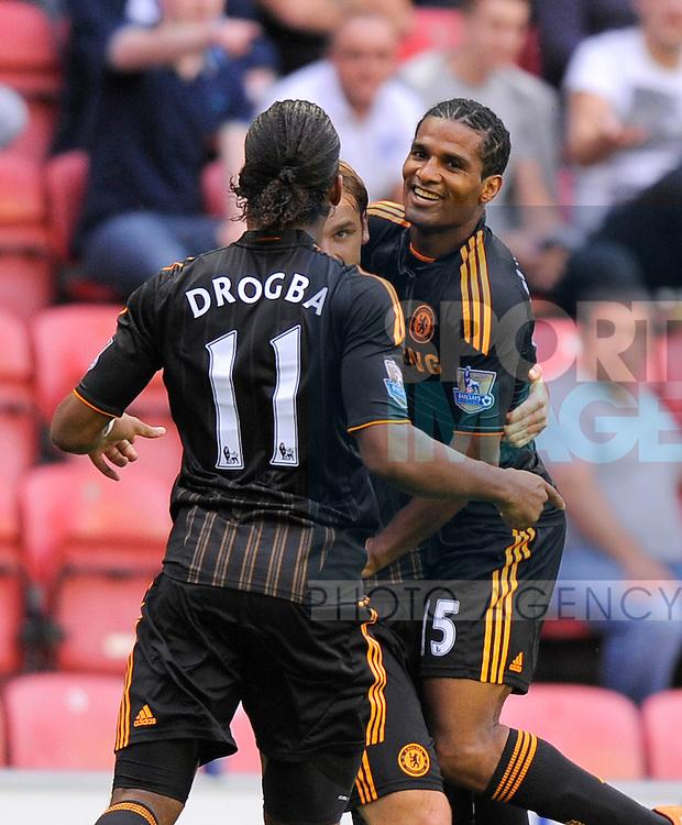 Florent Malouda of Chelsea celebrates scoring the opening goal